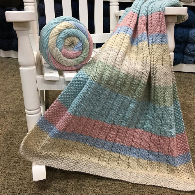 knitted car seat baby blanket pattern in worsted weight acrylic blend self-striping yarn Plymouth Yarn.